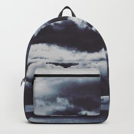 a boat sails alone at an abstract stormy cloudscape Backpack