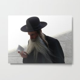 Orthodox Jew walking while reading in the old city of Jerusalem Metal Print