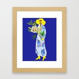 Faces on Her Dress Framed Art Print