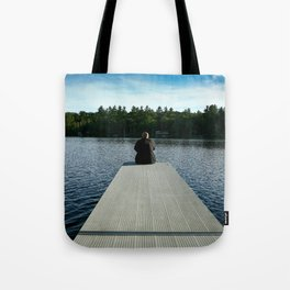 Dad sitting on the dock of the lake... Tote Bag