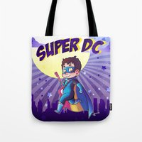 dc comics Tote Bags featuring Super DC by Sunshunes