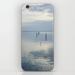 A blue lagoon and the water reflections iPhone Skin