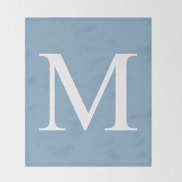 Letter M sign on placid blue background Throw Blanket