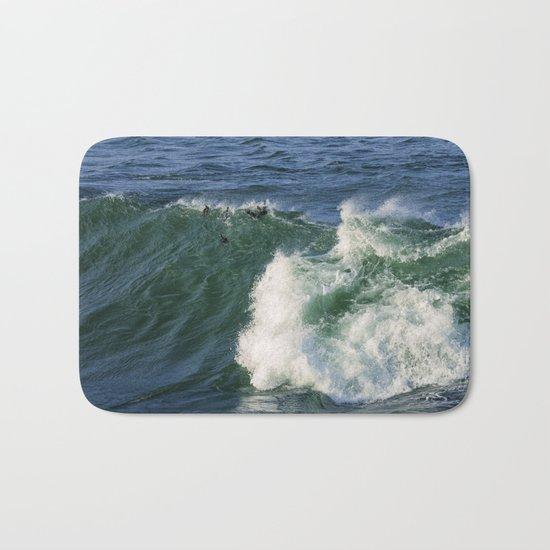 Ducks riding a wave Bath Mat