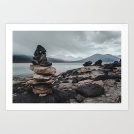 Cairn stack of rocks at Laguna Blanca on a stormy day in Bolivia Art Print