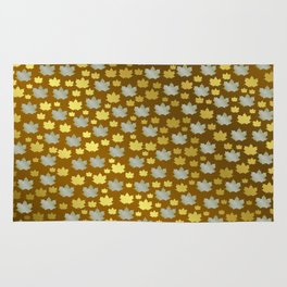 gold, silver, metal shiny maple leaf on shimmering texture Rug