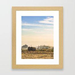 Hay bales in field at dawn Framed Art Print