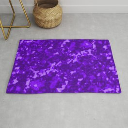 A chaotic cluster of violet bodies on a light background. Rug