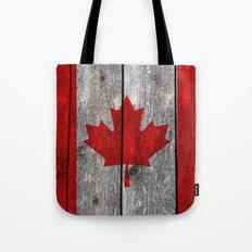Canada flag on heavily textured woodgrain  Tote Bag