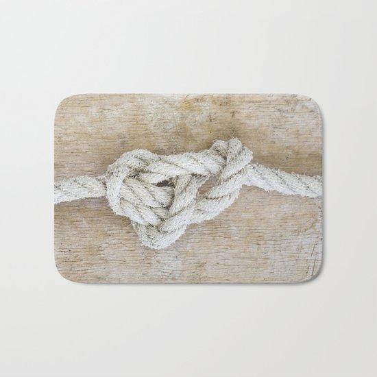 Knot on driftwood Bath Mat