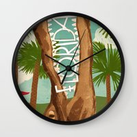 florida Wall Clocks featuring Florida by Santiago Uceda