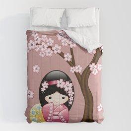 Japanese Spring Kokeshi Doll on Pink Comforters