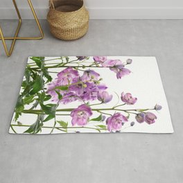 Purple delphinium flowers Rug