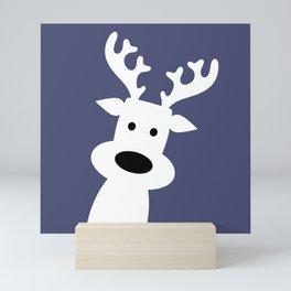 Reindeer on blue background Mini Art Print