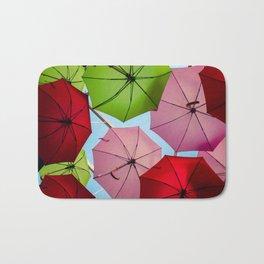 Colorful umbrellas. Bath Mat