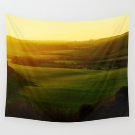 Sunrise Over Rolling Green Hills Wall Tapestry