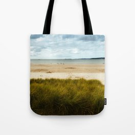 Beach against cloudy sky in Brittany Tote Bag