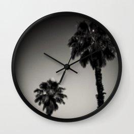 Why are palm trees so damn happy? Wall Clock