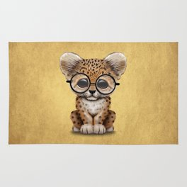 Cute Baby Leopard Cub Wearing Glasses on Yellow Rug