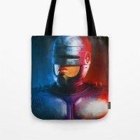 cyclops Tote Bags featuring CYCLOPS by John Aslarona