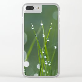 Field of grass filled with water drops of morning dew Clear iPhone Case