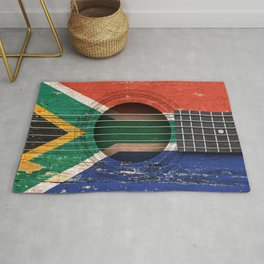 Old Vintage Acoustic Guitar with South African Flag Rug