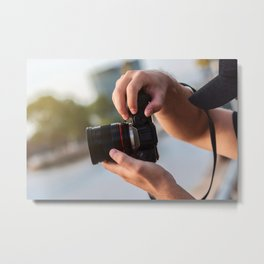 A photographer taking a picture with a camera Metal Print