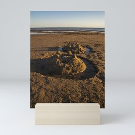 sandcastles on the beach Mini Art Print