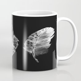 Three feathers on black background Coffee Mug