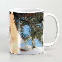 garfield Mugs featuring Winter Garfield  by Lucie