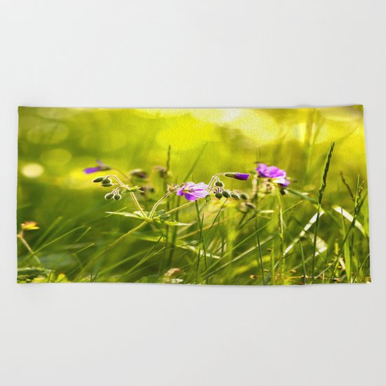 Beautiful meadow flowers - geranium on a sunny day - brilliant bright colors Beach Towel