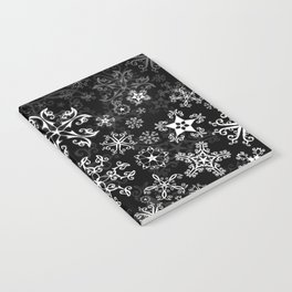 Symbols in Snowflakes on Black Notebook