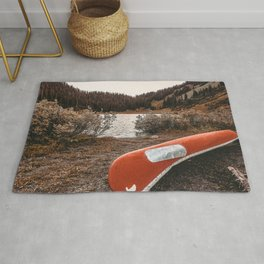 Rustic Autumn Canoe // Dusk Lit Gray Sky Pond Reflection in the Colorado Woodlands Rug