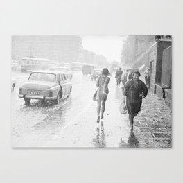 Girl running in the rain Canvas Print