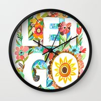 let it go Wall Clocks featuring Let Go by Katie Daisy