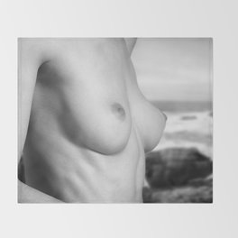 Nude woman at the cliff Throw Blanket