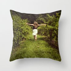 Young woman running through a vineyard Throw Pillow