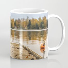 Pictuer of old slippers on the wooden pier with beautiful autumn background. Coffee Mug