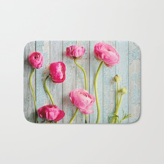 pink ranunculus Bath Mat