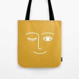 wink / mustard Tote Bag