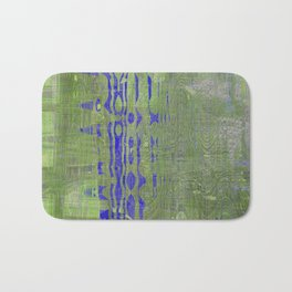 Blue shapes take over green and white messy background Bath Mat