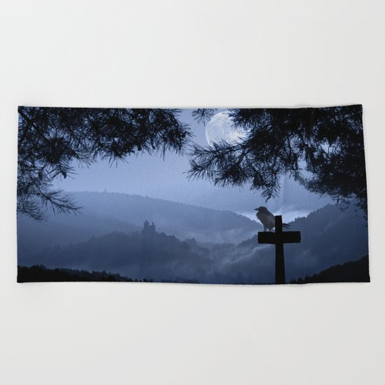Castle in a foggy night Beach Towel