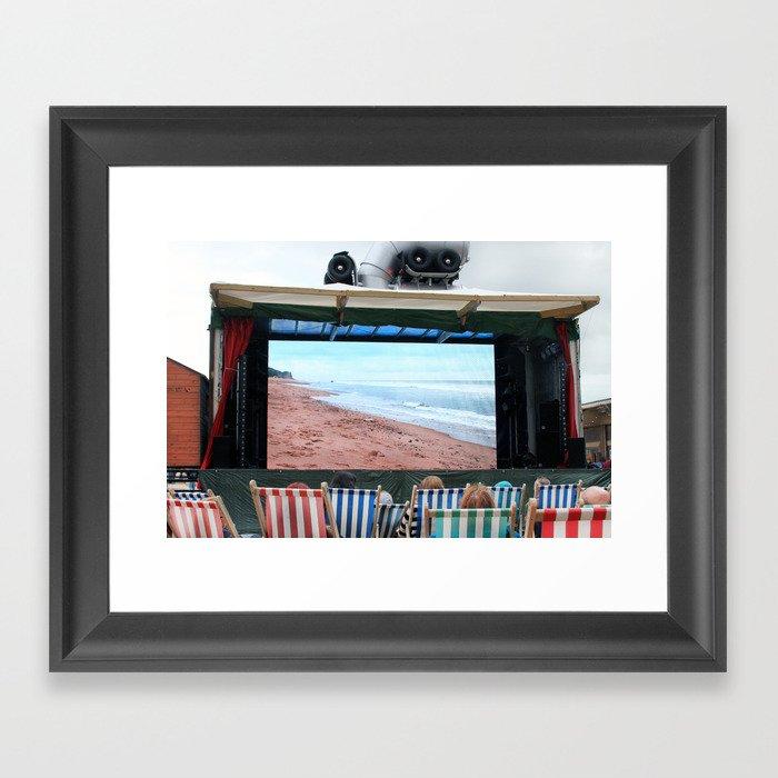 Watching the beach at Banksy's Dismaland Framed Art Print