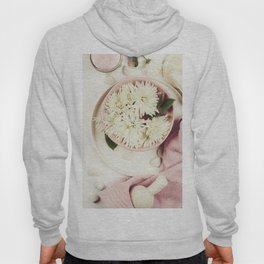 Spa setting with floating flowers Hoody