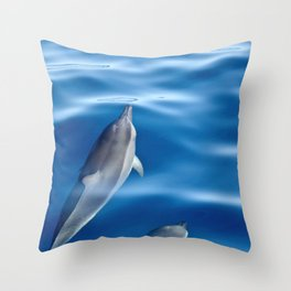 Dolphins racing Throw Pillow