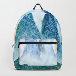 dawn in the mountain forest Backpack