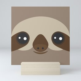 funny and cute smiling Three-toed sloth on brown background Mini Art Print