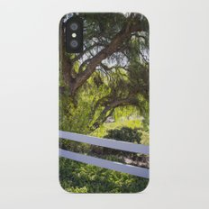 A Tree Next To A White Fence iPhone X Slim Case