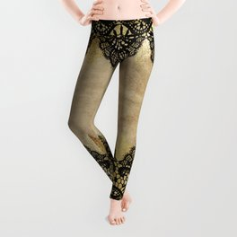 Elegance- Ornament black and gold lace on grunge paper backround Leggings