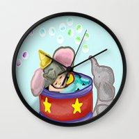 baby elephant Wall Clocks featuring Baby Elephant  by grapeloverarts